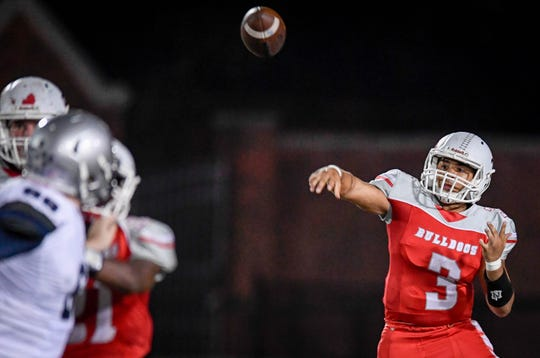 Bosse's Brennen Tompkins (3) launches a pass as the Reitz Panthers play the Bosse Bulldogs at Enlow Field Friday, October 5, 2018.