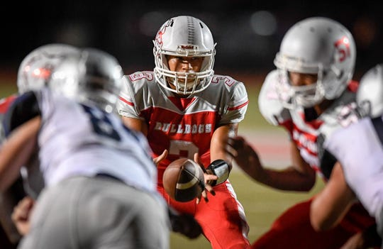 Bosse's Brennen Tompkins (3) takes the snap as the Reitz Panthers play the Bosse Bulldogs at Enlow Field Friday, October 5, 2018.