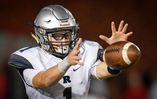 Reitz's Quarterback Eli Wiethop (1) takes the snap as the Reitz Panthers play the Bosse Bulldogs at Enlow Field Friday, October 5, 2018.