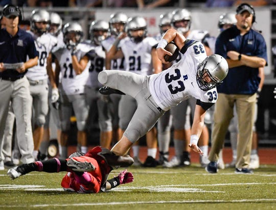 Reitz's Carter Schnarr (33)  is tripped up Bosse's Sheldon Clay (21)as the Reitz Panthers play the Bosse Bulldogs at Enlow Field Friday, October 5, 2018.