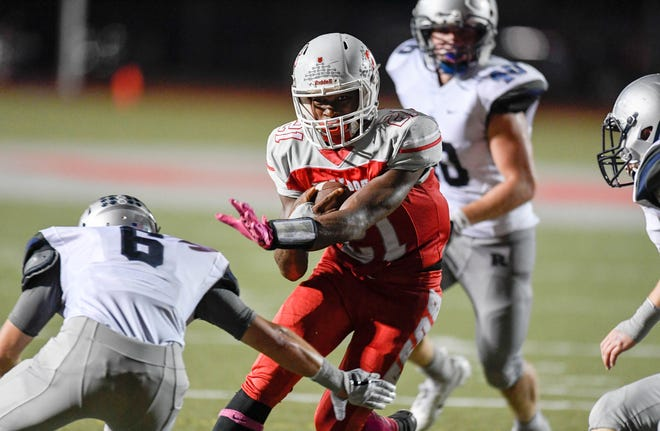 Bosse's Sheldon Clay (21) tries to run past defense from Reitz's Hunter Fox (6) as the Reitz Panthers play the Bosse Bulldogs at Enlow Field Friday, October 5, 2018.