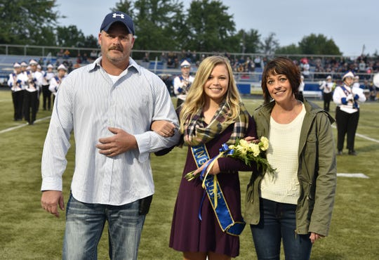 Clyde Homecoming Queen Jordan Roberts is escorted during the ceremony on Friday.
