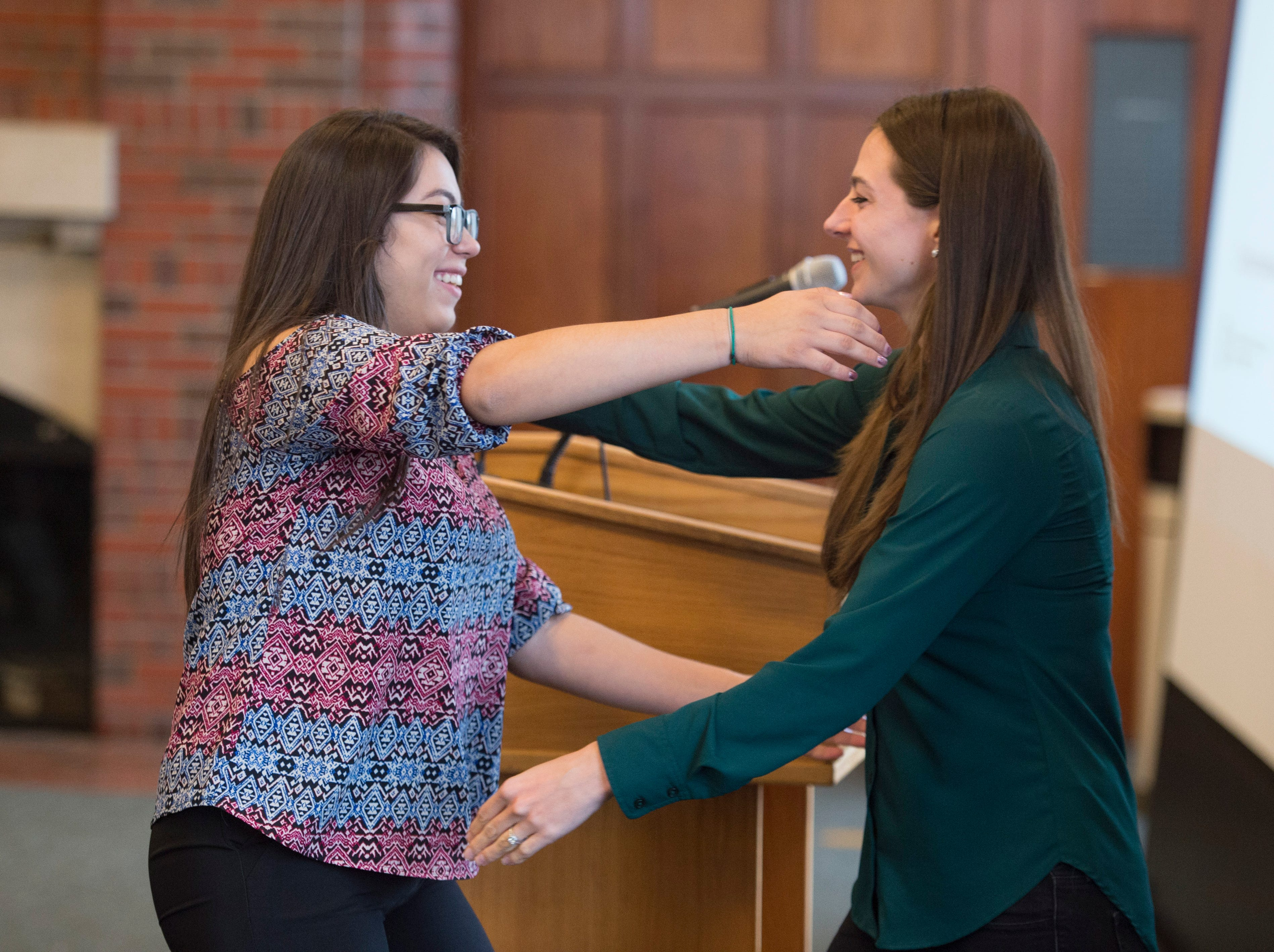 Litzy Fatima Lastra-Mendoza hugs Colordoan education reporter Kelly Ragan during the Coloradoan's First Class banquet at the University of Northern Colorado in Greeley on Saturday, October 6, 2018. First Class is a program that supports first-generation students in Northern Colorado. The program is now in its third year and is a partnership between The Coloradoan and Aims Community College, Fort Collins Lions Club, Front Range Community College, Colorado State University, Canvas Credit Union (formerly Public Service Credit Union) and University of Northern Colorado.