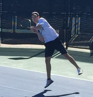 Fossil Ridge No. 1 singles player Jackson Holland returns a shot Friday at regional play where he finished first and qualified for the stat tournament