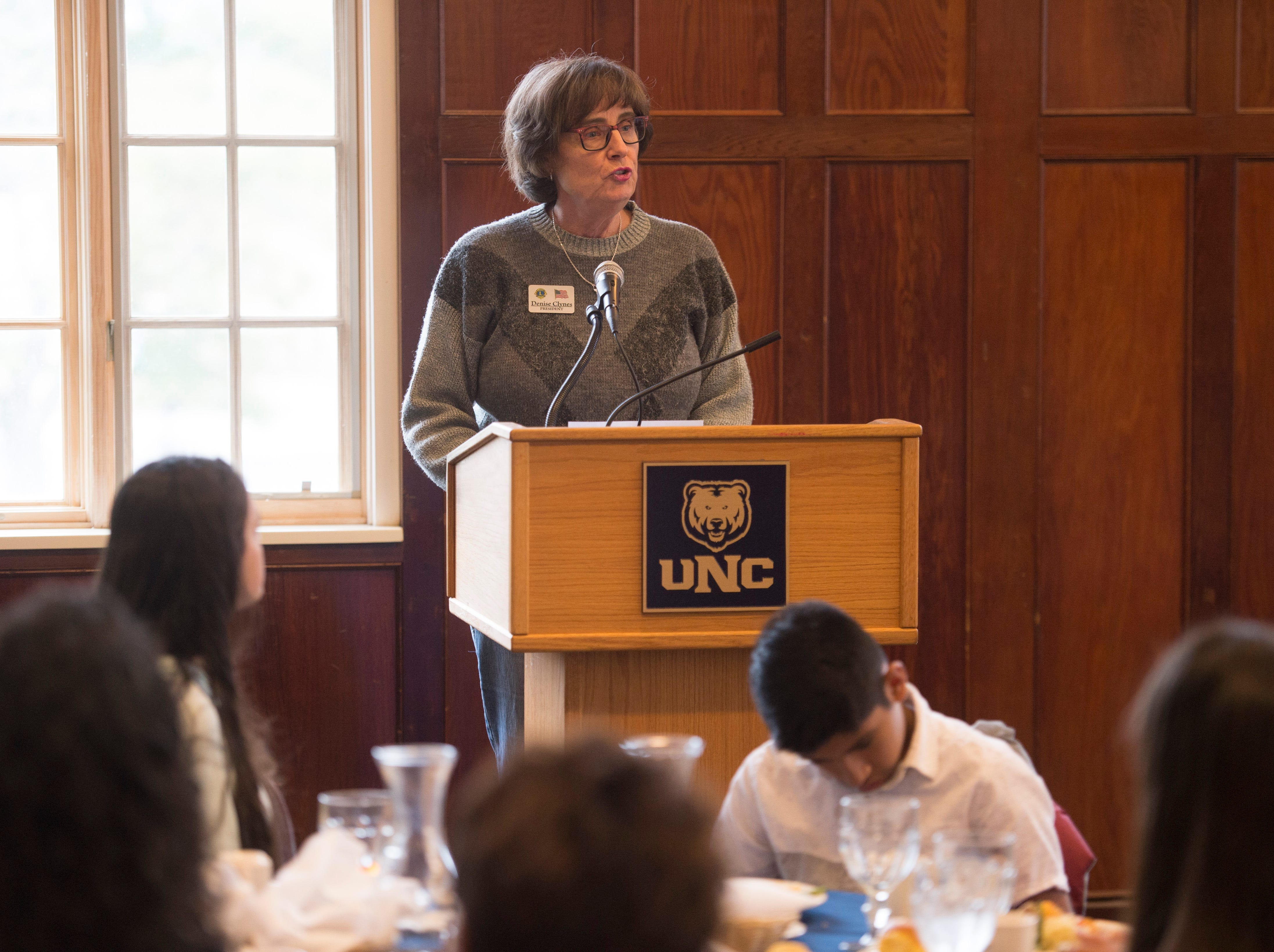 Denise Clynes, President of the Fort Collins Lions Club International, speaks during the Coloradoan's First Class banquet at the University of Northern Colorado in Greeley on Saturday, October 6, 2018. First Class is a program that supports first-generation students in Northern Colorado. The program is now in its third year and is a partnership between The Coloradoan and Aims Community College, Fort Collins Lions Club, Front Range Community College, Colorado State University, Canvas Credit Union (formerly Public Service Credit Union) and University of Northern Colorado.