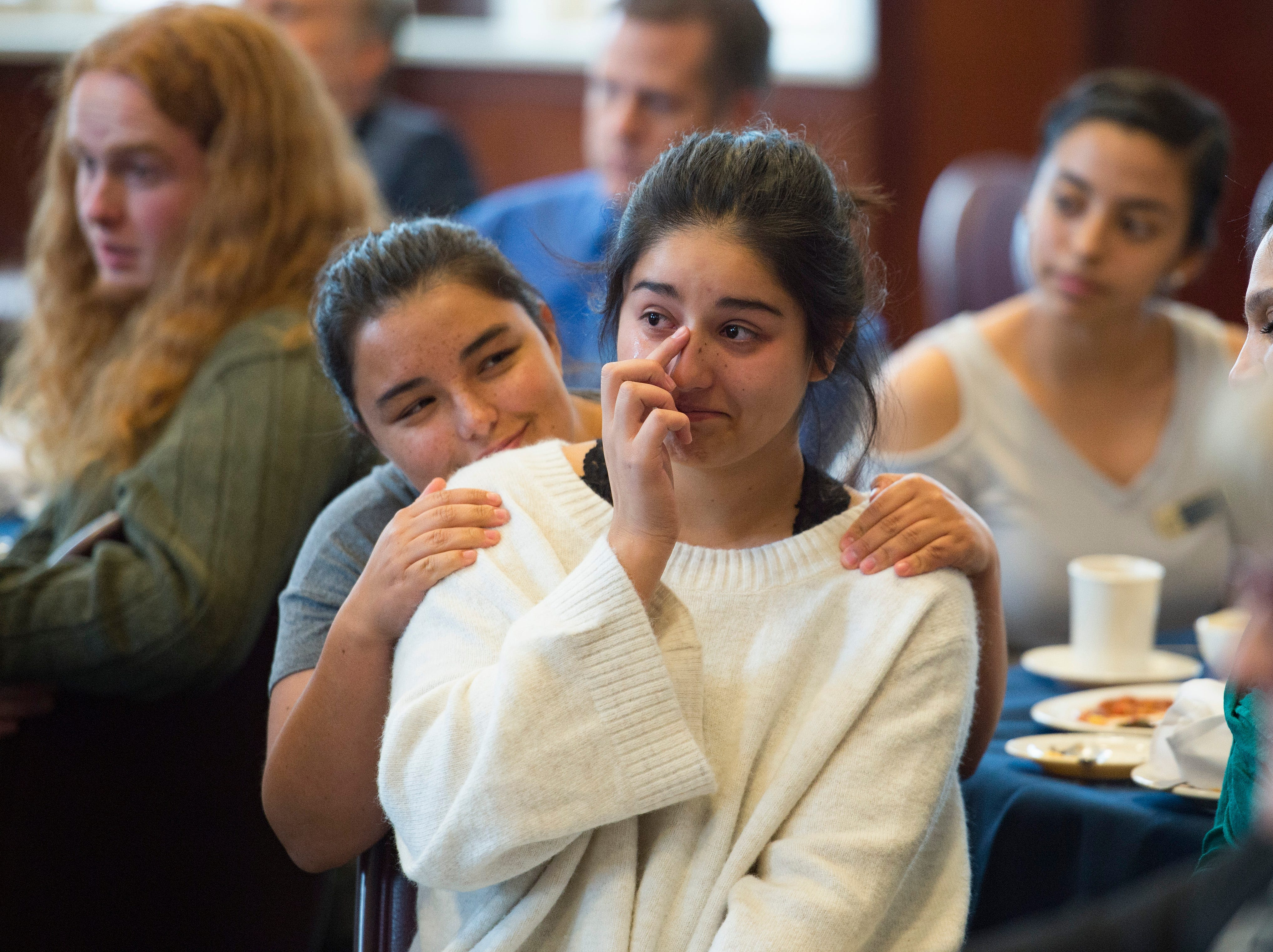 Anairis Trevizo wipes a tear from her eye as she is recognized as a First Class Scholar during the Coloradoan's First Class banquet at the University of Northern Colorado in Greeley on Saturday, October 6, 2018. First Class is a program that supports first-generation students in Northern Colorado. The program is now in its third year and is a partnership between The Coloradoan and Aims Community College, Fort Collins Lions Club, Front Range Community College, Colorado State University, Canvas Credit Union (formerly Public Service Credit Union) and University of Northern Colorado.