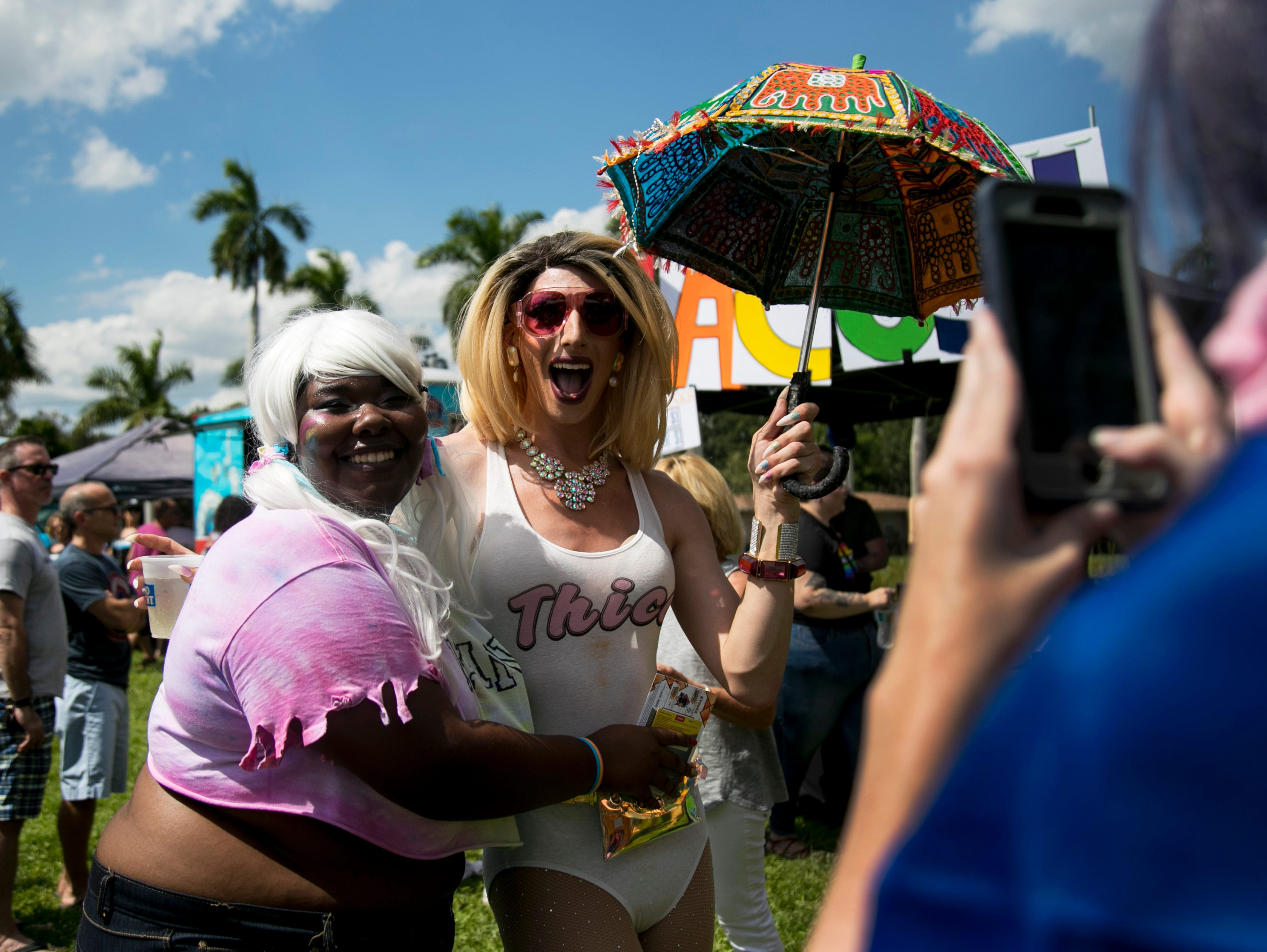 Luna McClinton, left, has her photo taken with Sizzy, a drag performer, at SWFL Pride on Saturday, October 6, 2018, in Fort Myers.