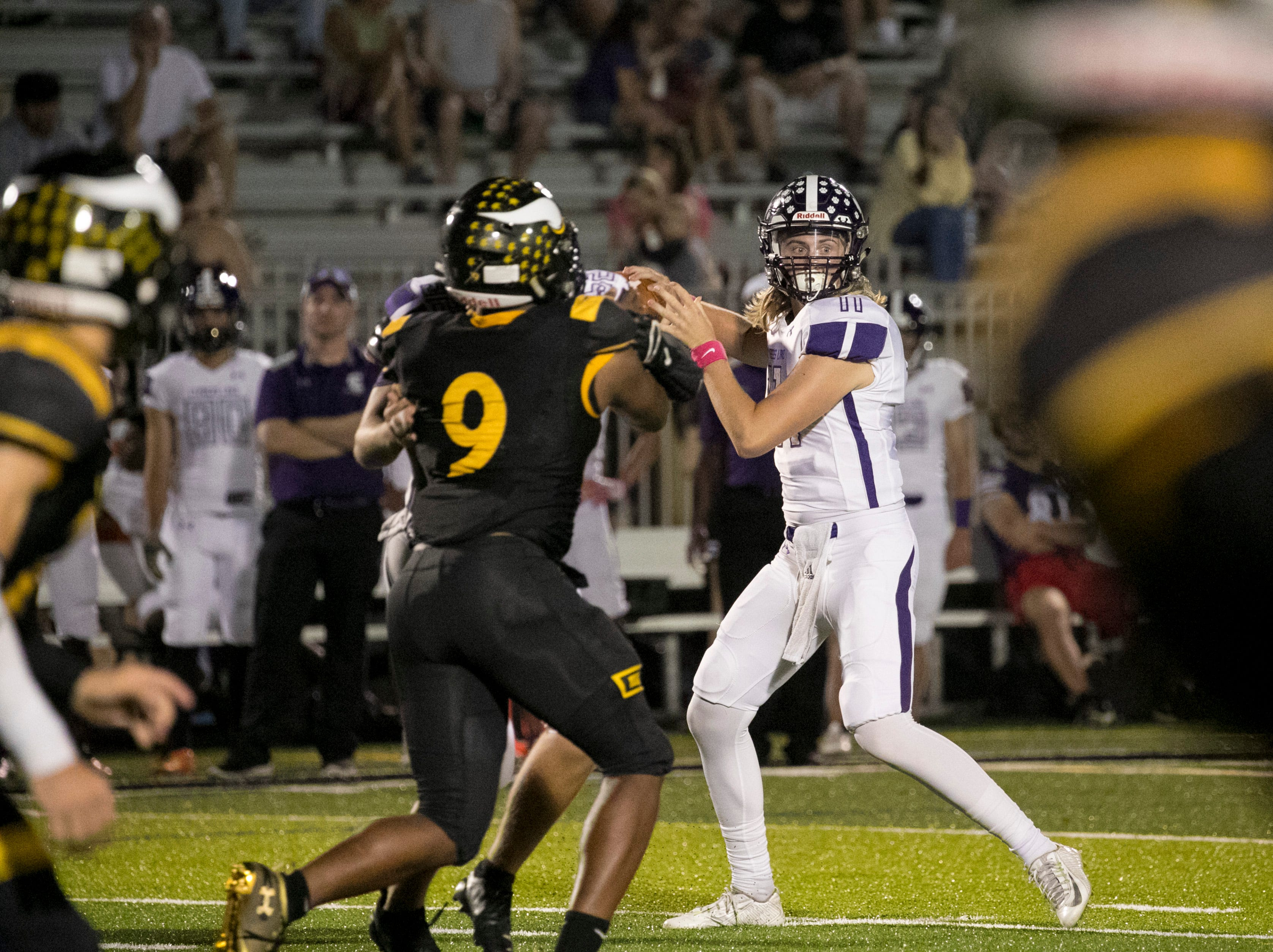 Cypress Lake quarterback C.J. Shedd looks to throw the ball against Bishop Verot on Friday night, October 5, 2018, in Fort Myers.