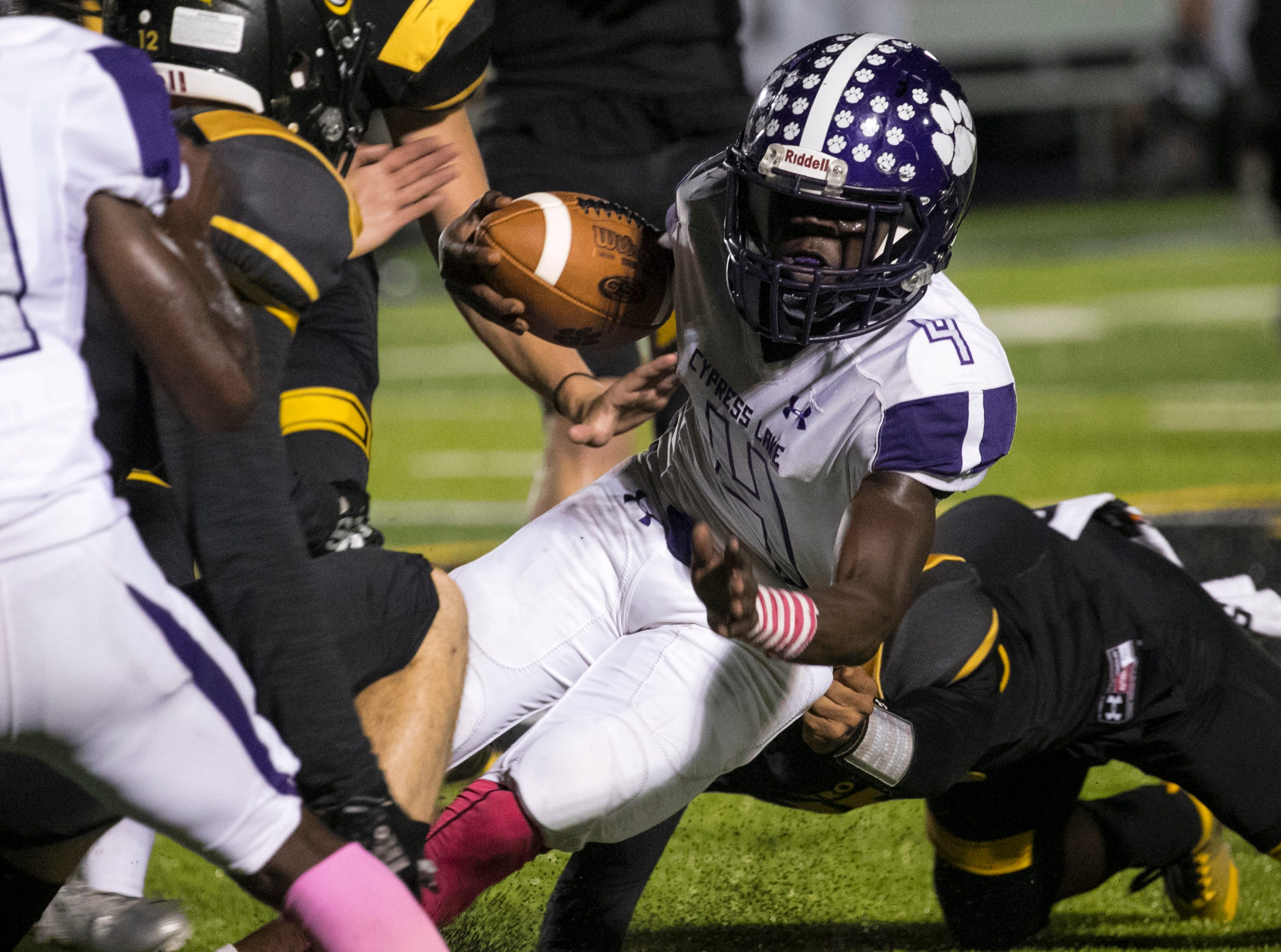 Koby Moore of Cypress Lake is brought down after a run by a Bishop Verot defender on Friday night, October 5, 2018, at Bishop Verot High School.