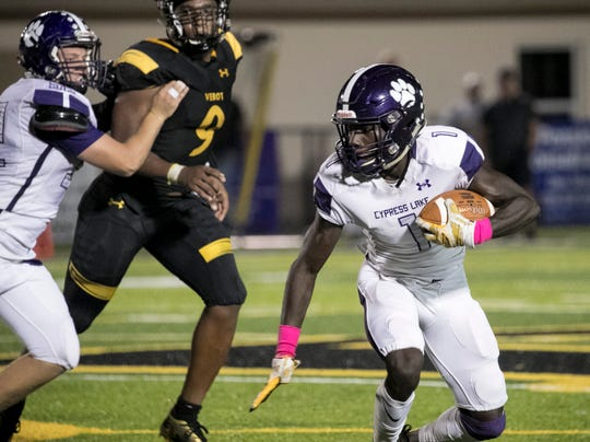 Kelsey Demps of Cypress Lake runs the ball against Bishop Verot on Friday, October 5, 2018, at Bishop Verot High School.