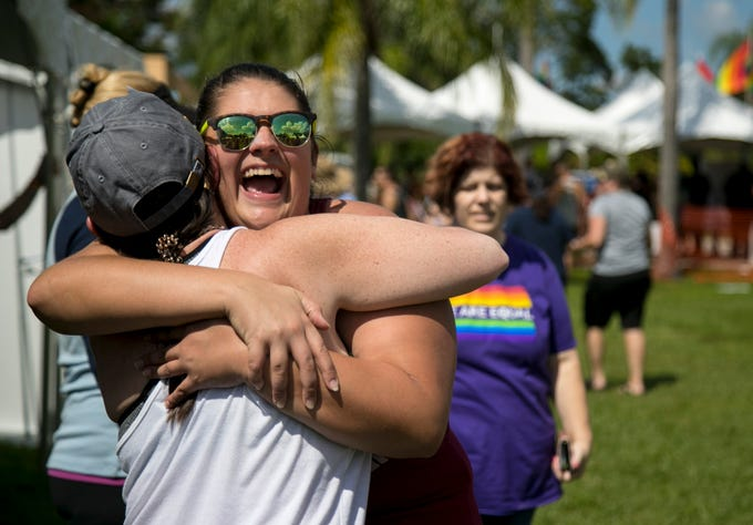 Jennifer Caissie of Fort Myers gets a hug from Elise Smith, left, on Saturday at SWFL Pride at the Alliance for the Arts in Fort Myers.
