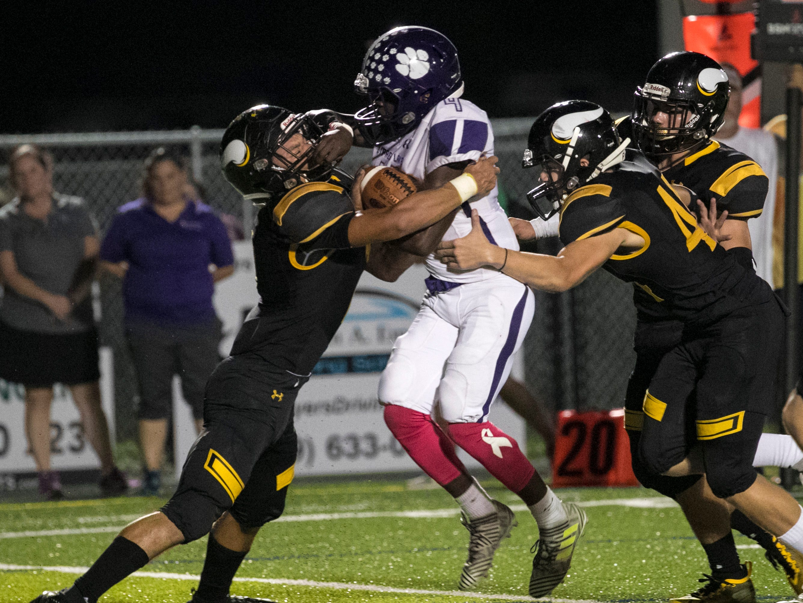 Koby Moore of Cypress Lake tries to get past Dominic Febels of Bishop Verot on Friday night, October 5, 2018, at Bishop Verot High School.