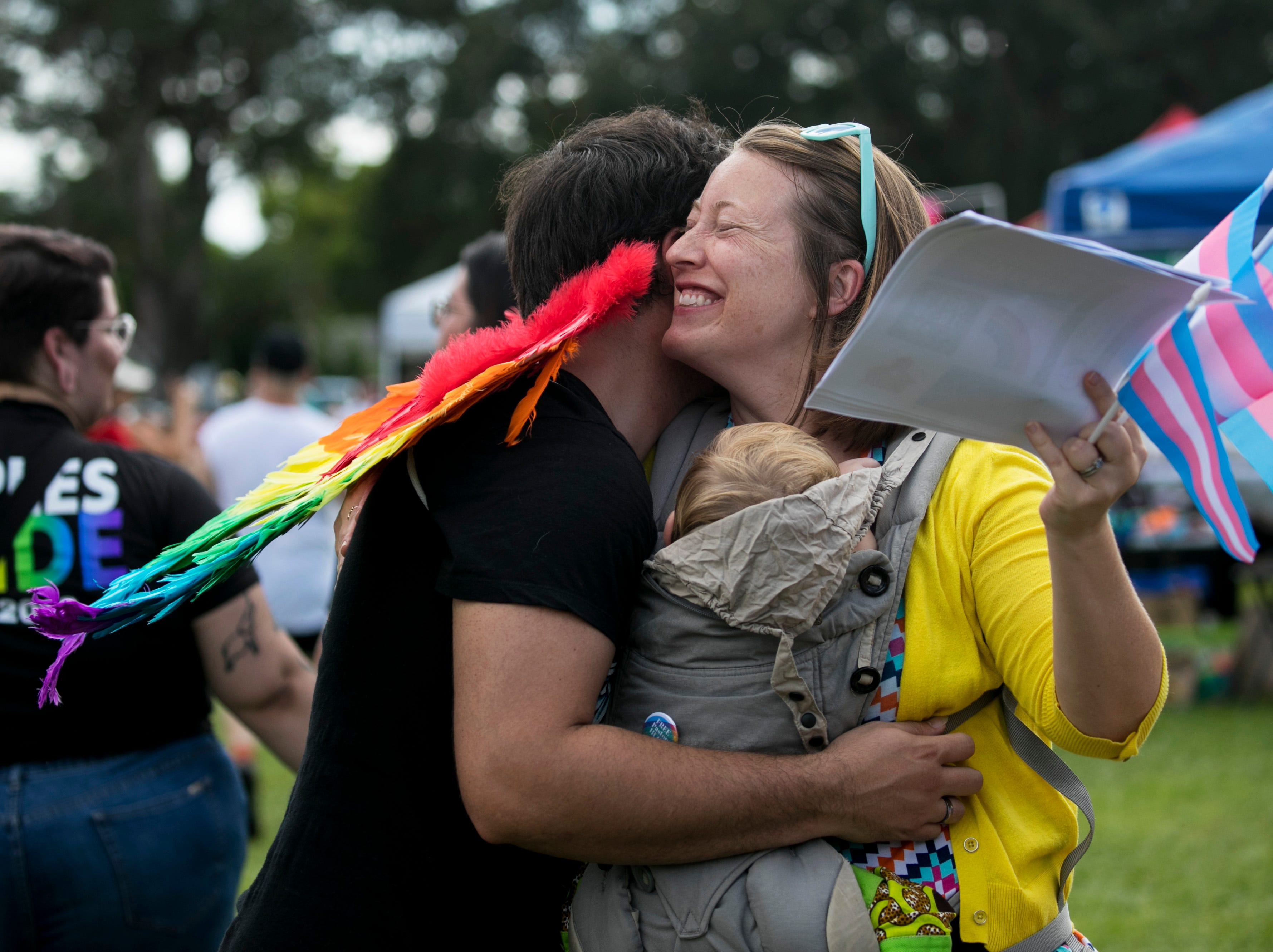 """Rev. Allison Farnum of the Unitarian Universalist Church of Fort Myers gives one of many """"mom hugs"""" at SWFL Pride on Saturday, October 6, 2018, at the Alliance for the Arts in Fort Myers. A group of moms, dads, grandmas, grandpas and sisters came together at the event to give out free hugs to everyone who needed to feel loved."""