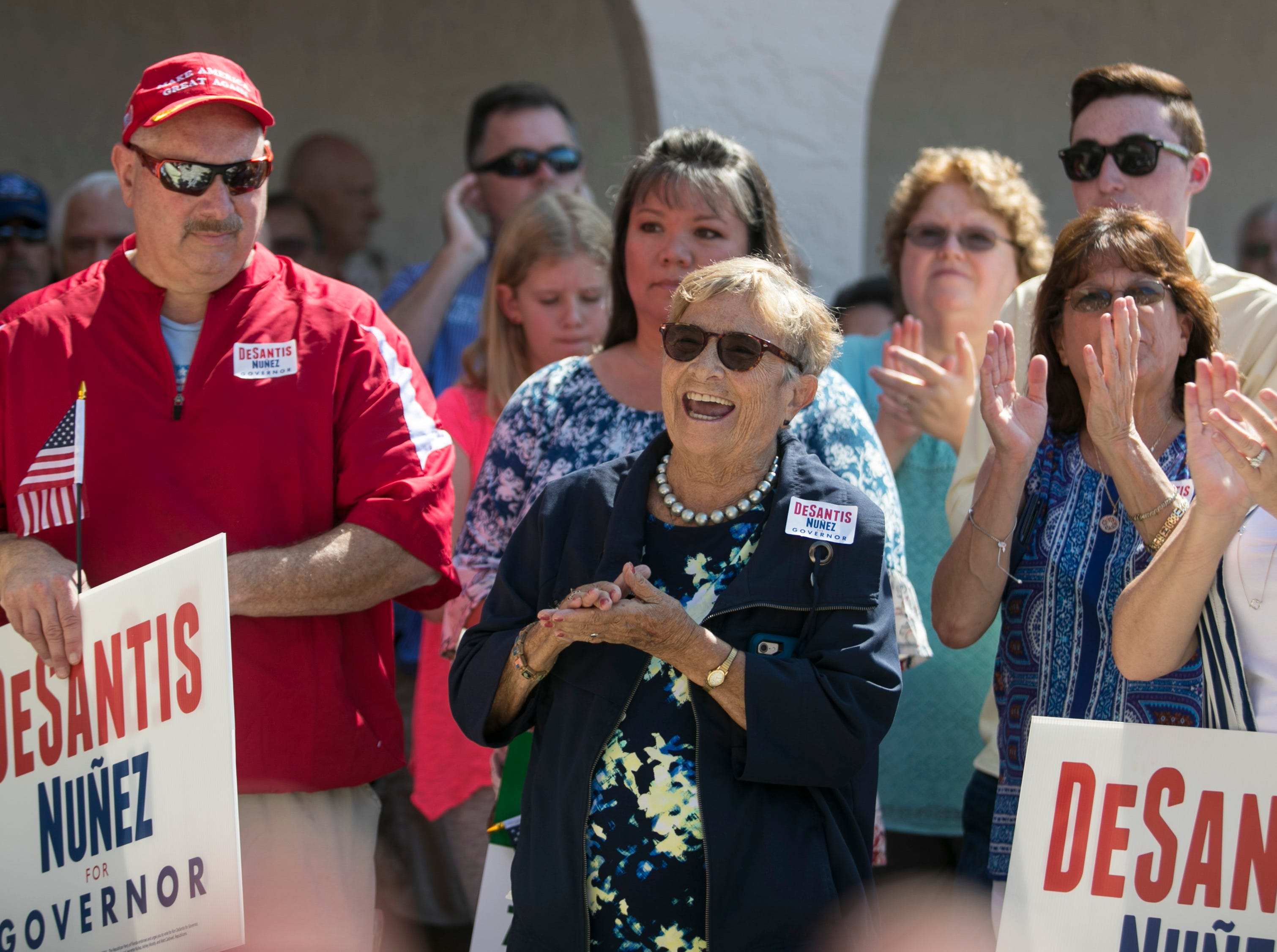 Supporters of Ron DeSantis applaud during his speech at his campaign office in Cape Coral on Saturday, October 6, 2018.