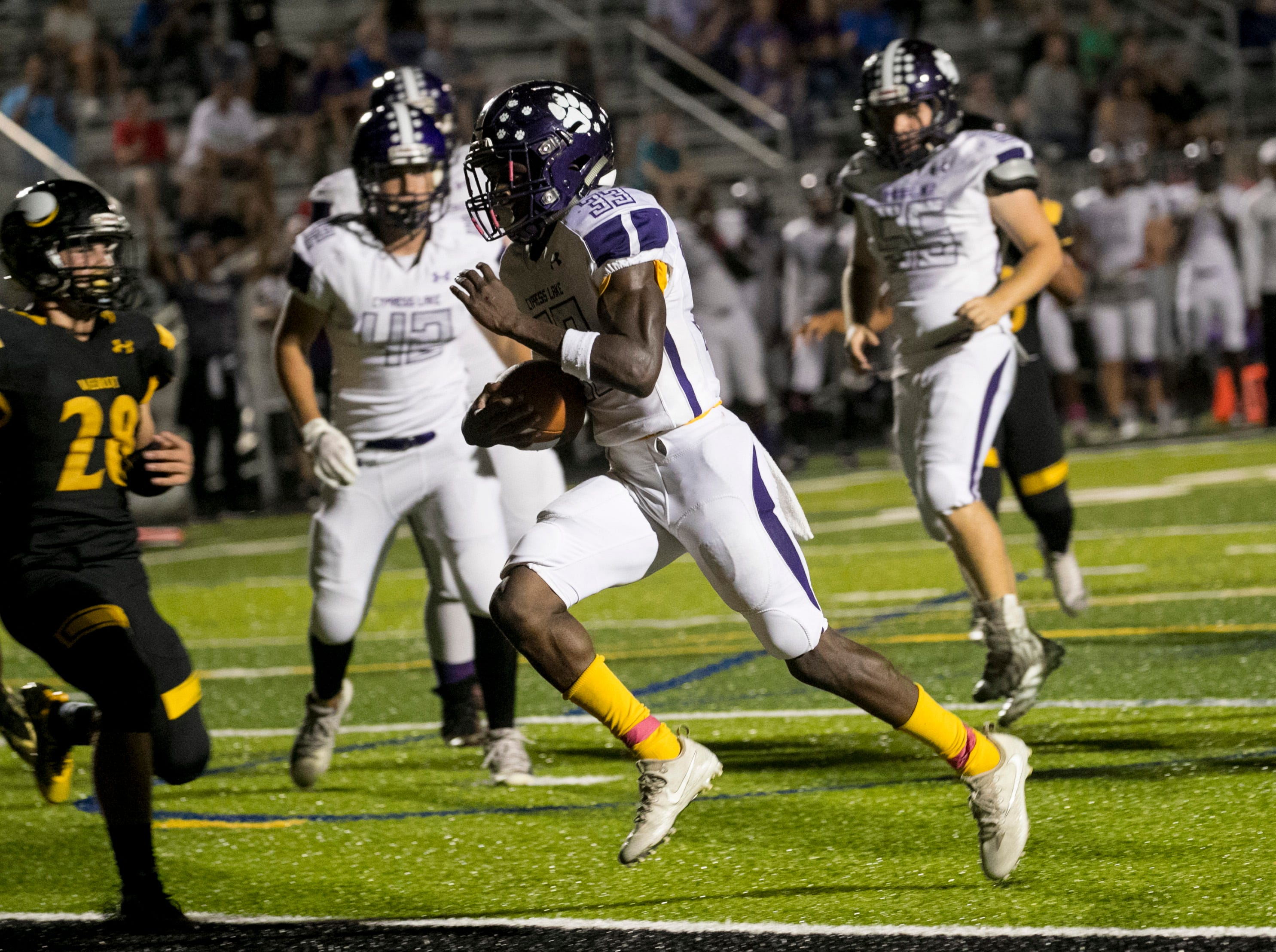 Chris Joseph of Cypress Lake runs in a touchdown against Bishop Verot on Friday night, October 5, 2018, at Bishop Verot High School.
