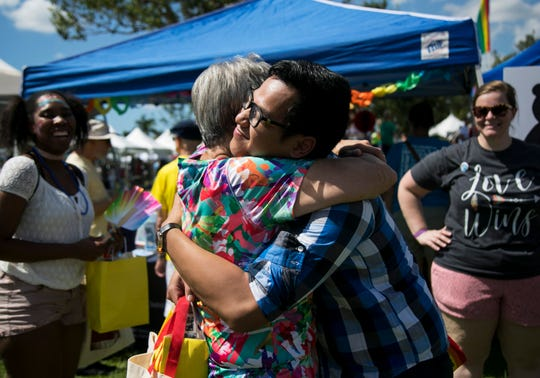 Judy Greenberger gives Anthony Phan a big hug at the Free Hugs booth on Saturday, October 6, 2018, during SWFL Pride at the Alliance for the Arts in Fort Myers.