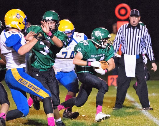 Coleman's Mason Risner picks up big yardage on a play in the second quarter in the game with Oconto on Friday, Oct. 5.