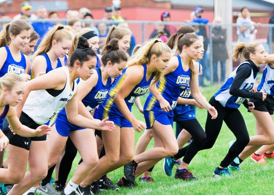 Oconto's Morgan Durand, Ellen Sohrweide, and Chantelle Marotz take off at the sound of the starting gun at the Lena Invite held Tuesday, Oct. 2.
