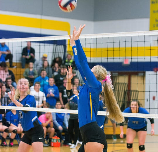 Oconto's Baliegh Gering sets up a teammate for an attack in the second nd game against Peshtigo on Thursday, Oct. 4.