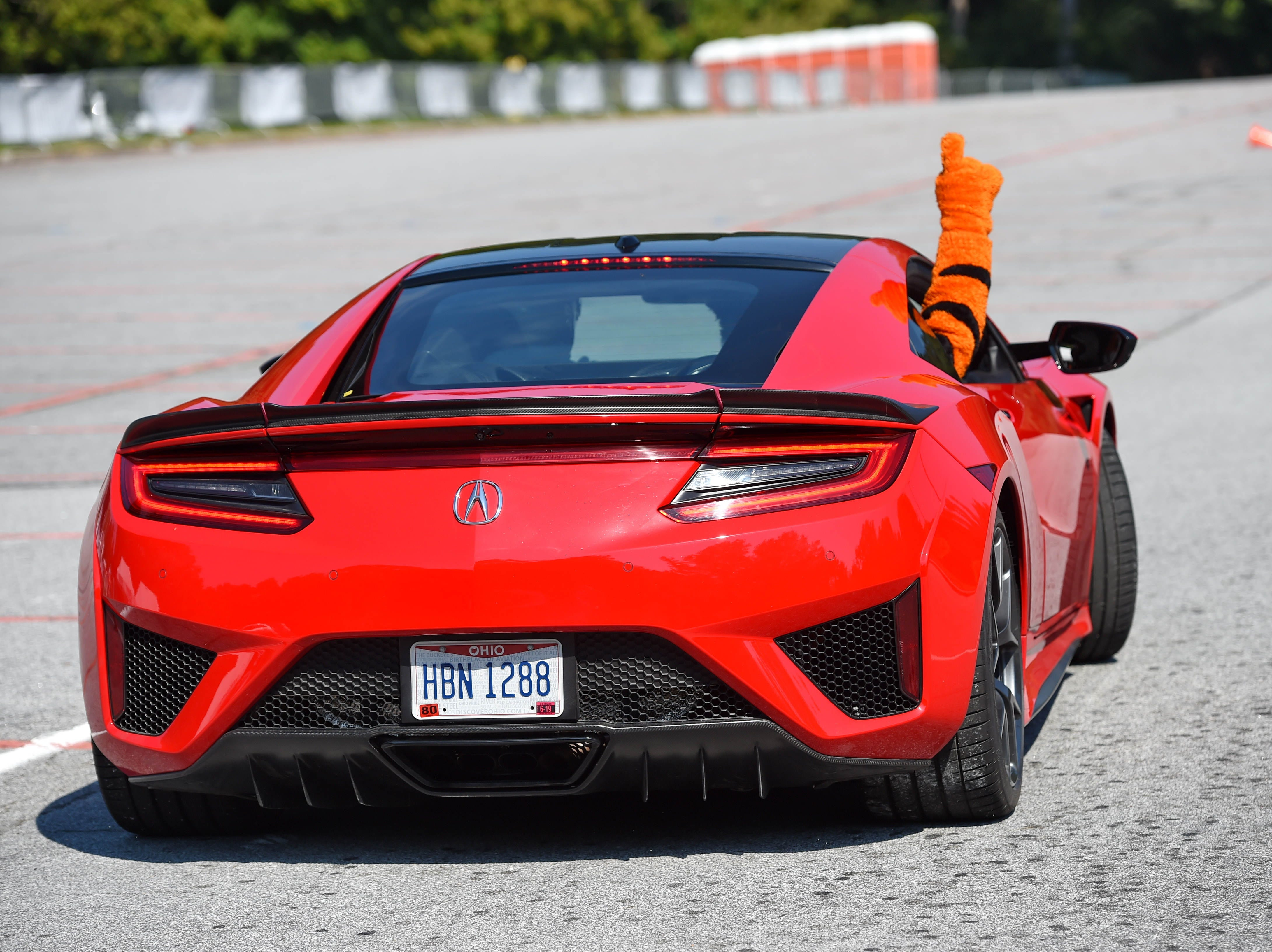 """Professional driver for Honda, Dennis Grisez takes Clemson mascot """"Tiger"""" out for a hot lap during an event to unveil the new Deep Orange 9 rally car by CU-ICAR Saturday, October 6,  2018."""