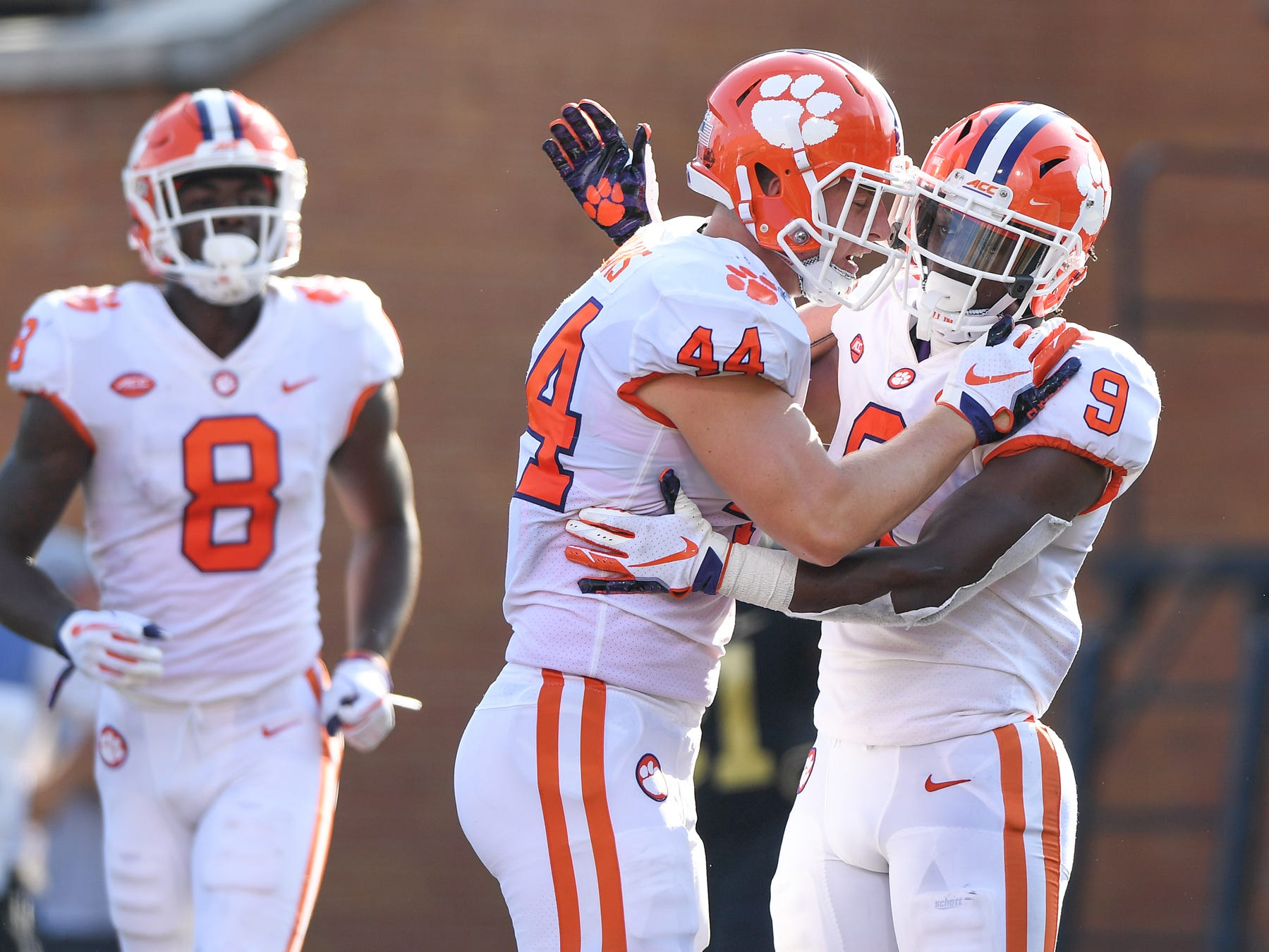 Clemson running back Travis Etienne (9) celebrates with tight end Garrett Williams (44) after scoring against Wake Forest during the 2nd quarter at BB&T Field in Winston Salem, N.C. Saturday, October 6, 2018.