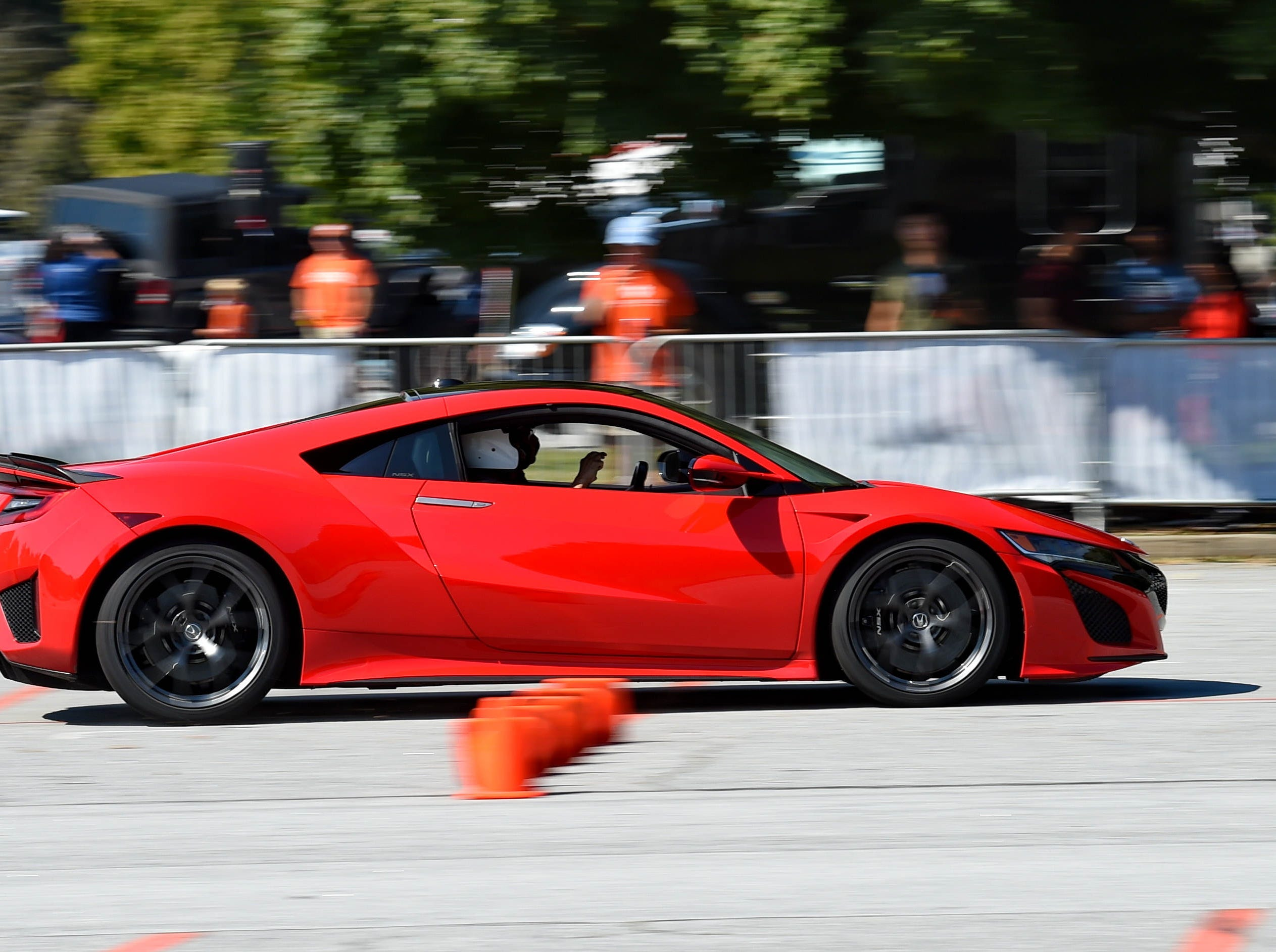 Professional driver for Honda, Dennis Grisez takes participants out for a hot lap during an event to unveil the new Deep Orange 9 rally car by CU-ICAR Saturday, October 6,  2018.