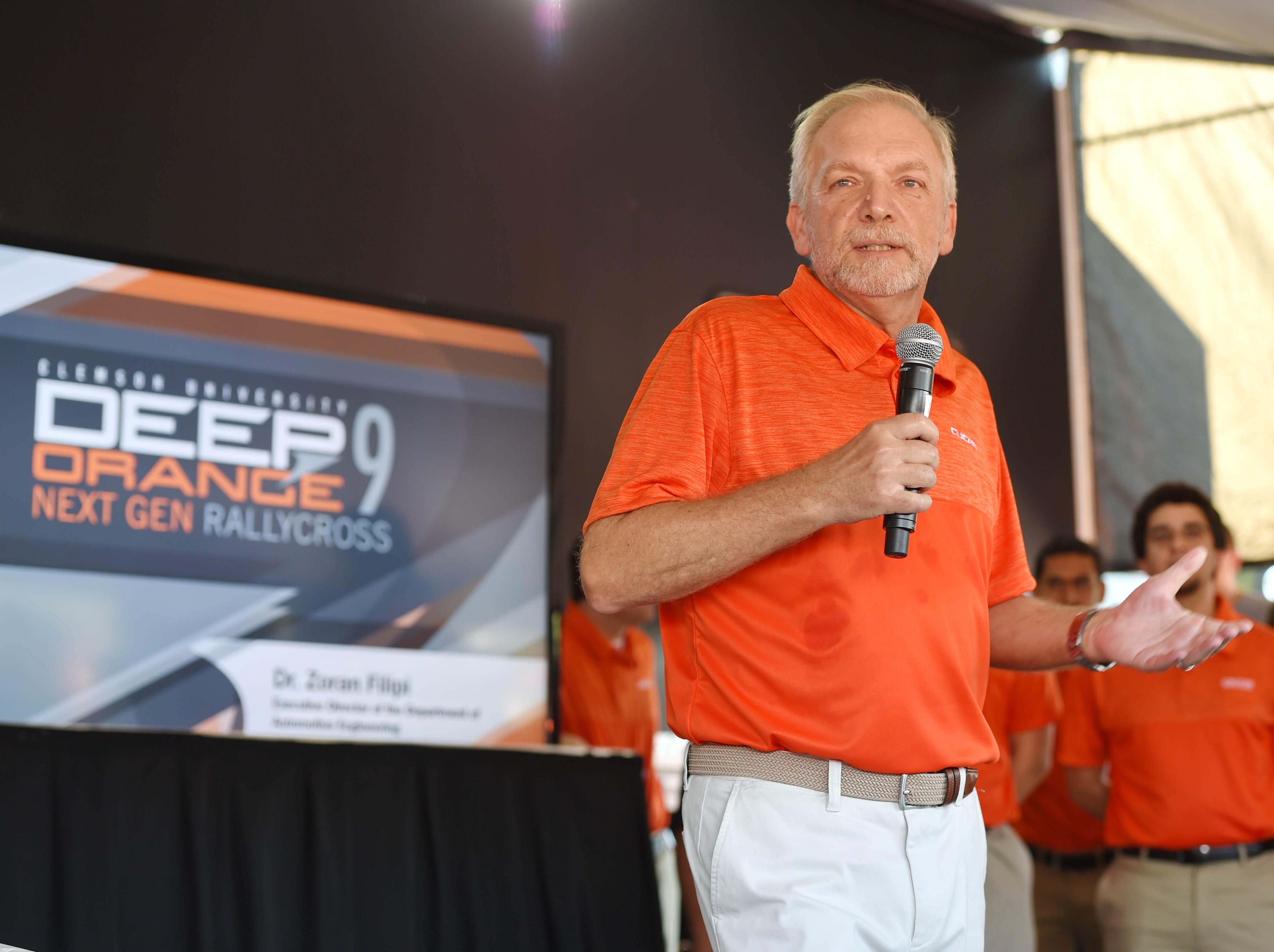 Dr. Zoran Filipi speaks to the crowd during the CU-ICAR unveiling of the new Deep Orange 9 rally car Saturday, October 6,  2018.