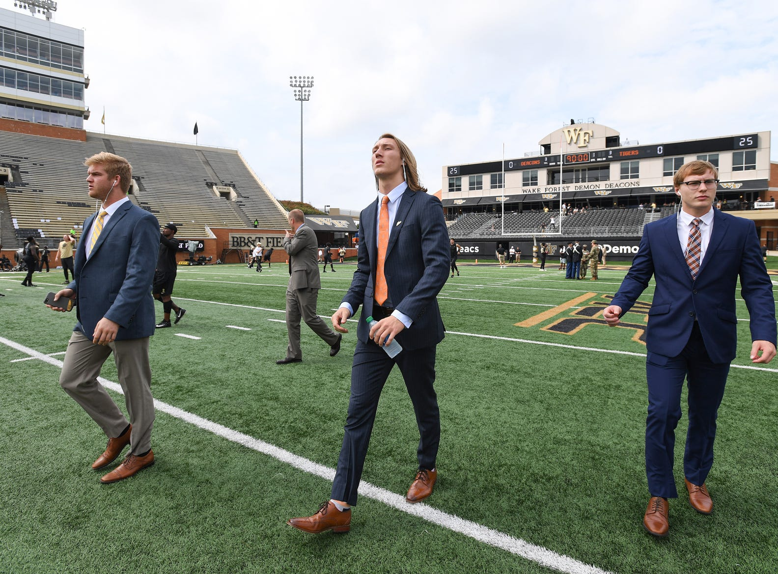 Clemson quarterbacks quarterbacks, from left, Chase Brice, Trevor Lawrence, and Ben Batson look over Wake Forest's BB&T Field in Winston Salem Saturday, October 6, 2018.
