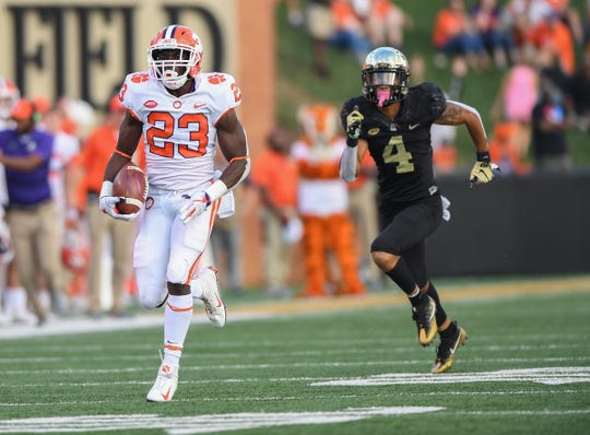 Clemson running back Lyn-J Dixon (23) races 65 yards to score against Wake Forest during the 3rd quarter at BB&T Field in Winston Salem, N.C. Saturday, October 6, 2018.