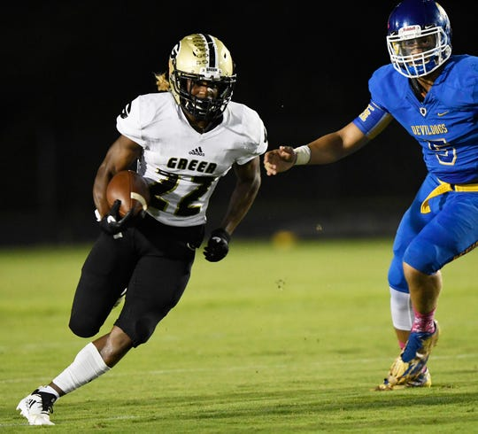 Greer's Dre Williams (22) scores on his team's first play against Travelers Rest.