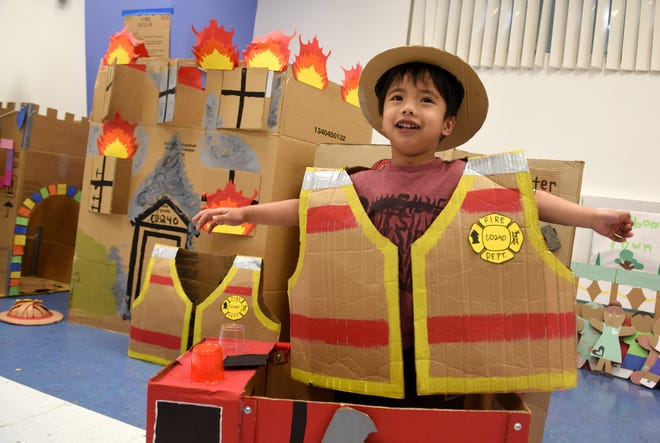 Michael James Aquino is ready to put out a make-believe inferno after donning a cardboard fire suit and helmet during the 5th Annual Global Cardboard Challenge at the Guam Community College in Mangilao on Saturday, Oct. 6, 2018.