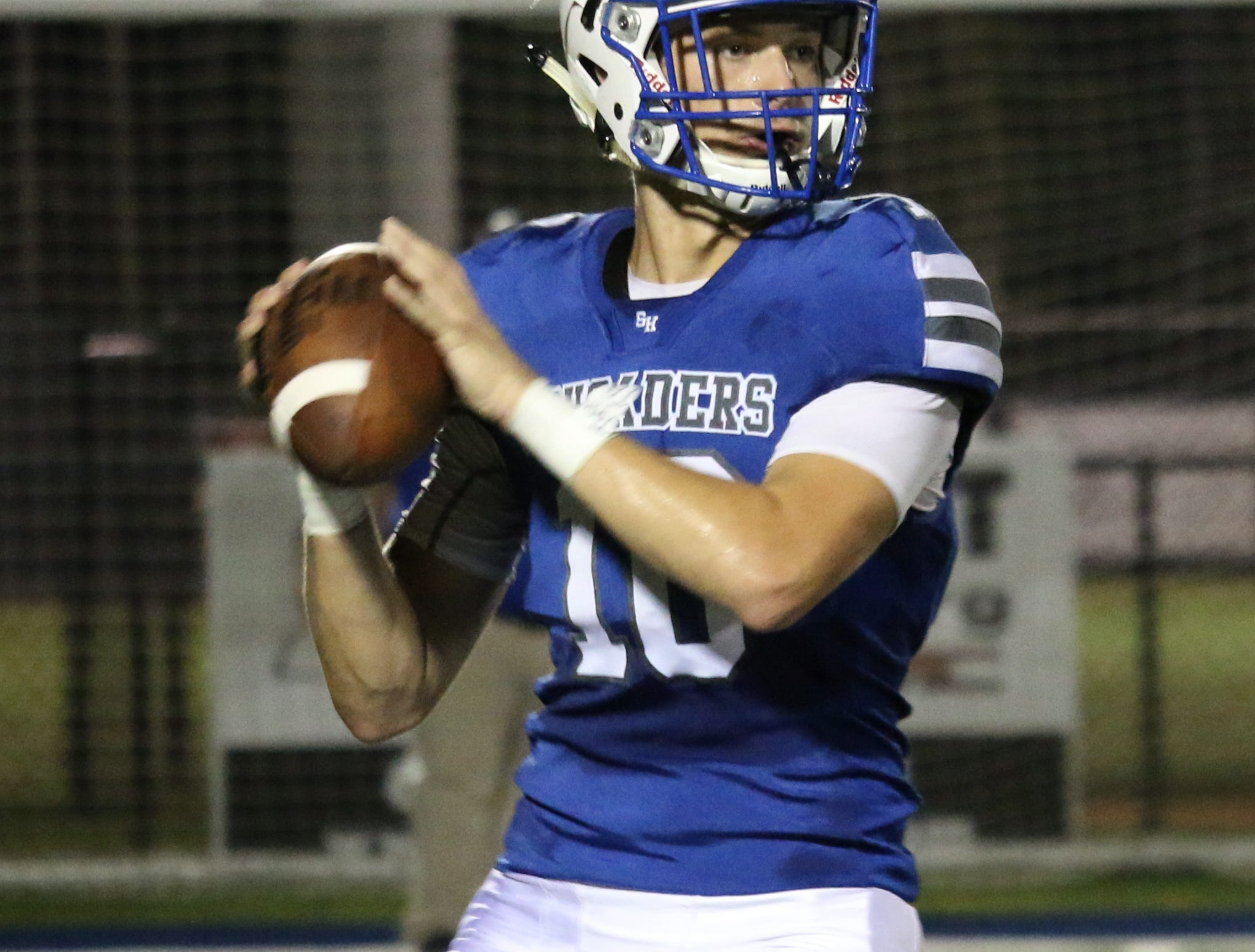 Sacred Heart's QB Zach Weatherell searches for an opening against East Marion on Friday.