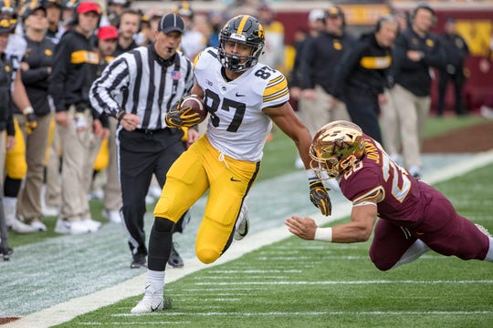 Oct 6, 2018; Minneapolis, MN, USA; Iowa Hawkeyes tight end Noah Fant (87) rushes for a first down after making a catch as Minnesota Golden Gophers linebacker Julian Huff (20) attempts to make a tackle in the first half at TCF Bank Stadium. Mandatory Credit: Jesse Johnson-USA TODAY Sports