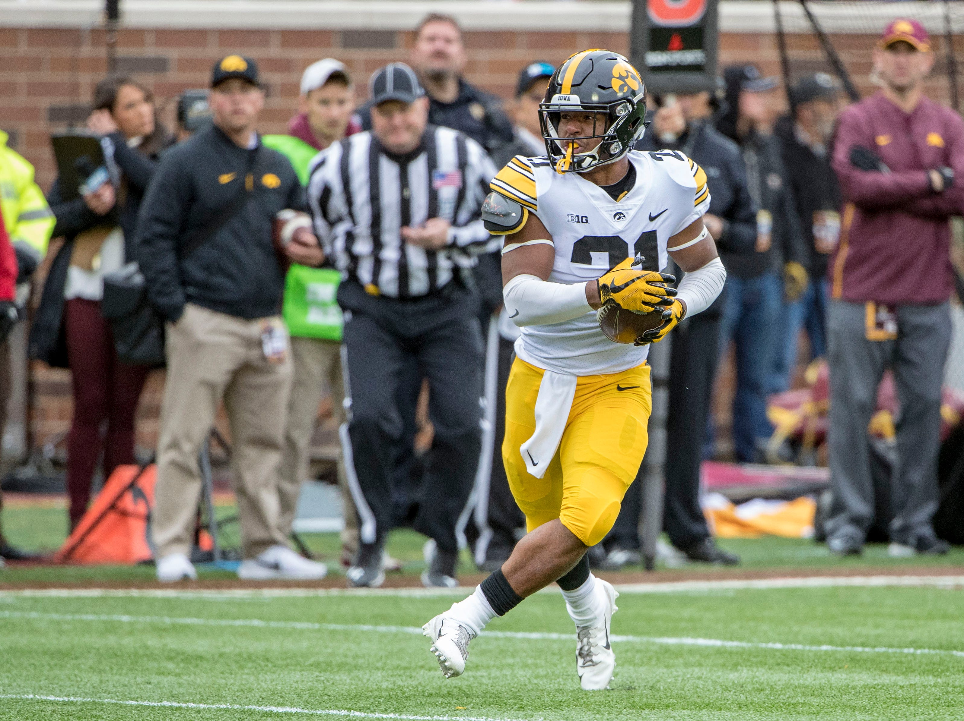 Oct 6, 2018; Minneapolis, MN, USA; Iowa Hawkeyes running back Ivory Kelly-Martin (21) runs the ball against the Minnesota Golden Gophers in the first half at TCF Bank Stadium. Mandatory Credit: Jesse Johnson-USA TODAY Sports
