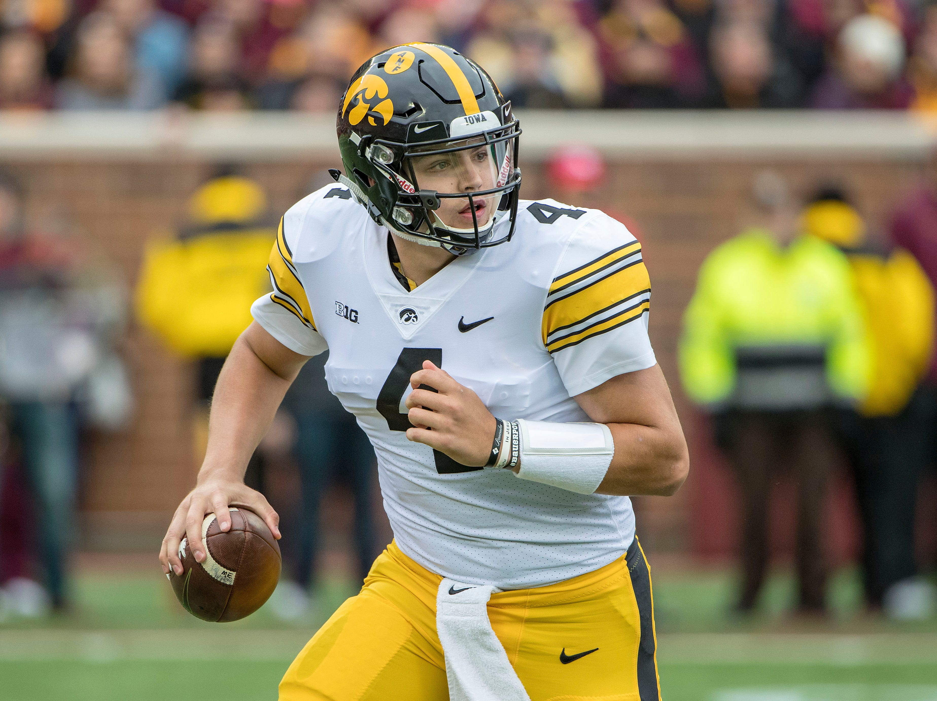 Oct 6, 2018; Minneapolis, MN, USA; Iowa Hawkeyes quarterback Nate Stanley (4) drops back for a pass in the first half against the Minnesota Golden Gophers at TCF Bank Stadium. Mandatory Credit: Jesse Johnson-USA TODAY Sports