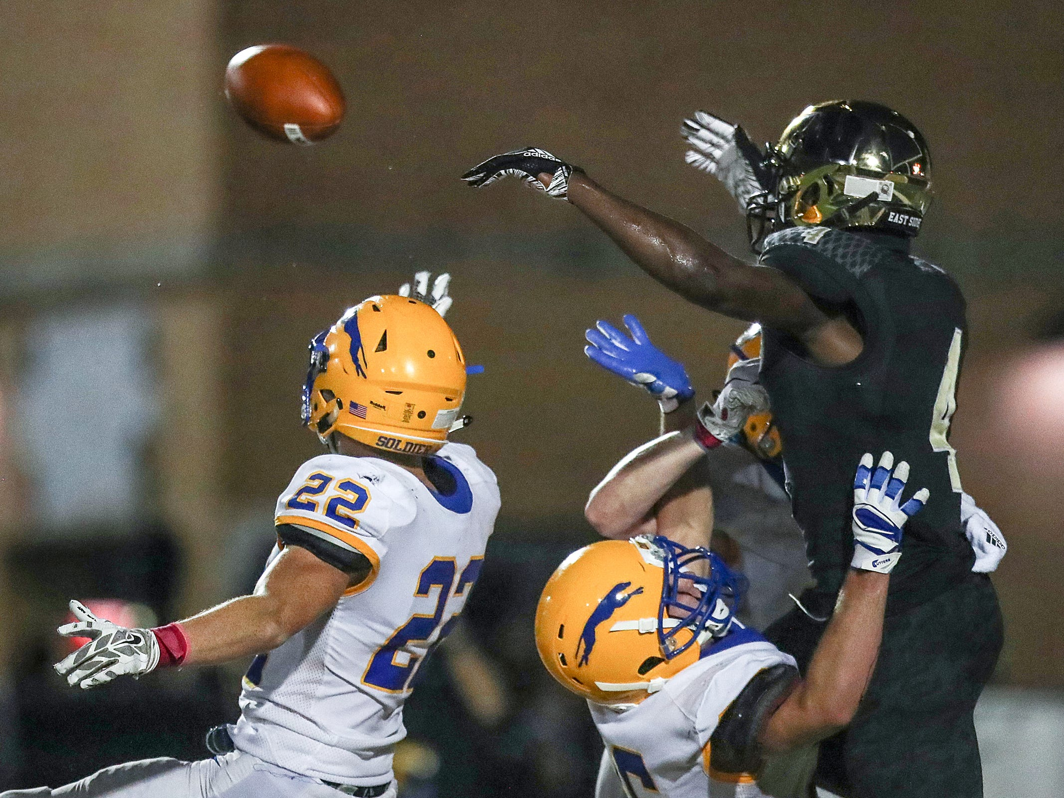 Carmel Greyhounds Nate Frey (22) knocks away a pass intended for Warren Central Warriors wide receiver David Bell (4), forcing a fourth down in the first half of the game at Warren Central High School, Indianapolis, Ind., Friday, Oct. 5, 2018.