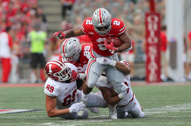 Oct 6, 2018; Columbus, OH, USA; Ohio State Buckeyes running back J.K. Dobbins (2) tackled by Indiana Hoosiers defensive lineman Gavin Everett (69) during the second quarter at Ohio Stadium. Mandatory Credit: Joe Maiorana-USA TODAY Sports