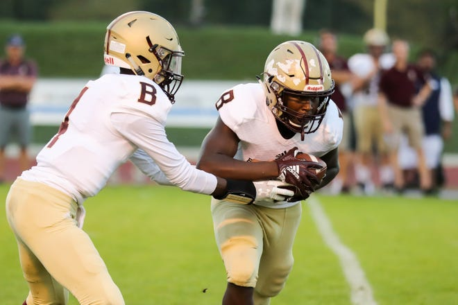 Brebeuf's Caleb Ellison (4) hands the ball off to Brebeuf's Isaiah Martin (32) during the first half of Guerin Catholic vs. Brebeuf Jesuit varsity high school football held at Guerin Catholic High School, Friday, October 5, 2018.