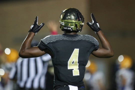 Warren Central Warriors wide receiver David Bell (4) celebrates a touchdown by Romeir Elliott (21), leaving the score 41-17 in the second half of the game at Warren Central High School, Indianapolis, Ind., Friday, Oct. 5, 2018. Warren Central won, 41-17.