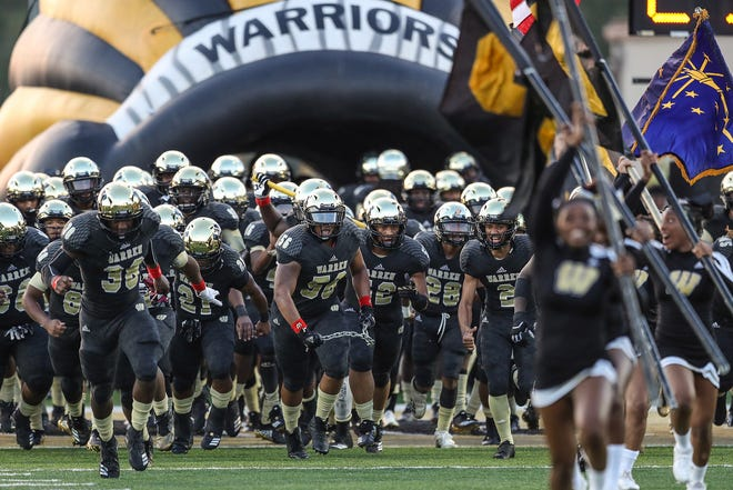 The Warren Central Warriors take the field to face the Carmel Greyhounds at Warren Central High School, Indianapolis, Ind., Friday, Oct. 5, 2018.