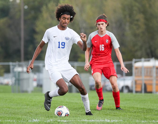 Hamilton Southeastern Royals Zaden Eby-Holmes (19) works his possession as Fishers Tigers Jonah Chapple (16) defends behind in the first half of IHSAA sectional finals at Hamilton Southeastern in Fishers, Ind., Saturday, Oct. 6, 2018. Hamilton Southeastern won in double overtime, 2-1.