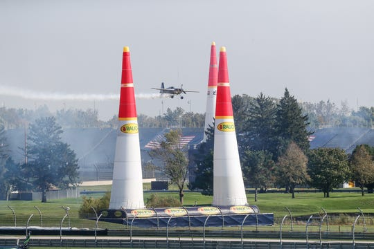 Germany's Florian Berger, #62, flies the Red Bull Air Race course before qualifying for the Red Bull Air Race at the Indianapolis Motor Speedway, on Saturday, Oct. 6, 2018.