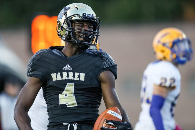 Warren Central Warriors wide receiver David Bell (4) celebrates a reception early in the first half of the game at Warren Central High School, Indianapolis, Ind., Friday, Oct. 5, 2018.