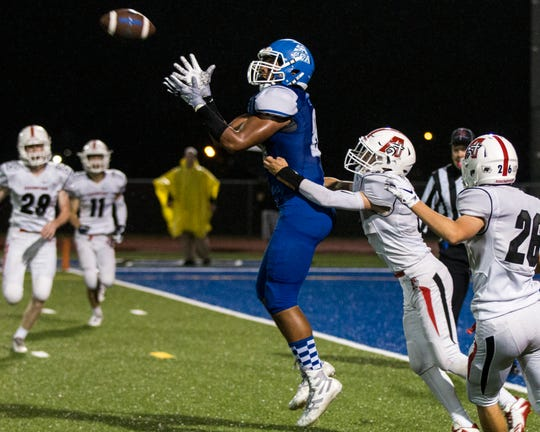 Clear Creek Amana's T.J. Bollers (88) comes down with a ball while being double covered during a Class 3A varsity football game on Friday evening, Oct. 5, 2018, at Clear Creek Amana Stadium in Tiffin, Iowa.