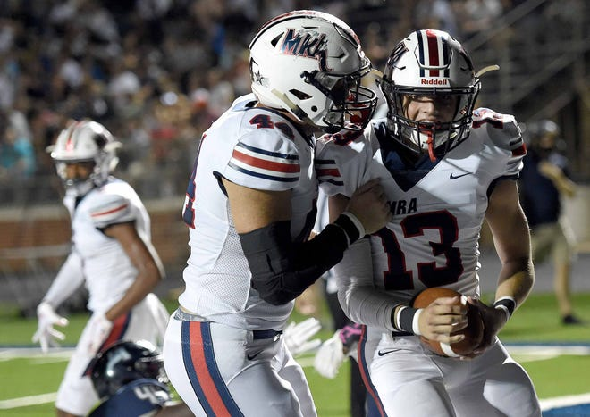 MRA's Ridge Futral (13) celebrates his touchdown against JA with John Cartwright (44) on Friday, October 5, 2018, at Jackson Academy in Jackson, Miss.