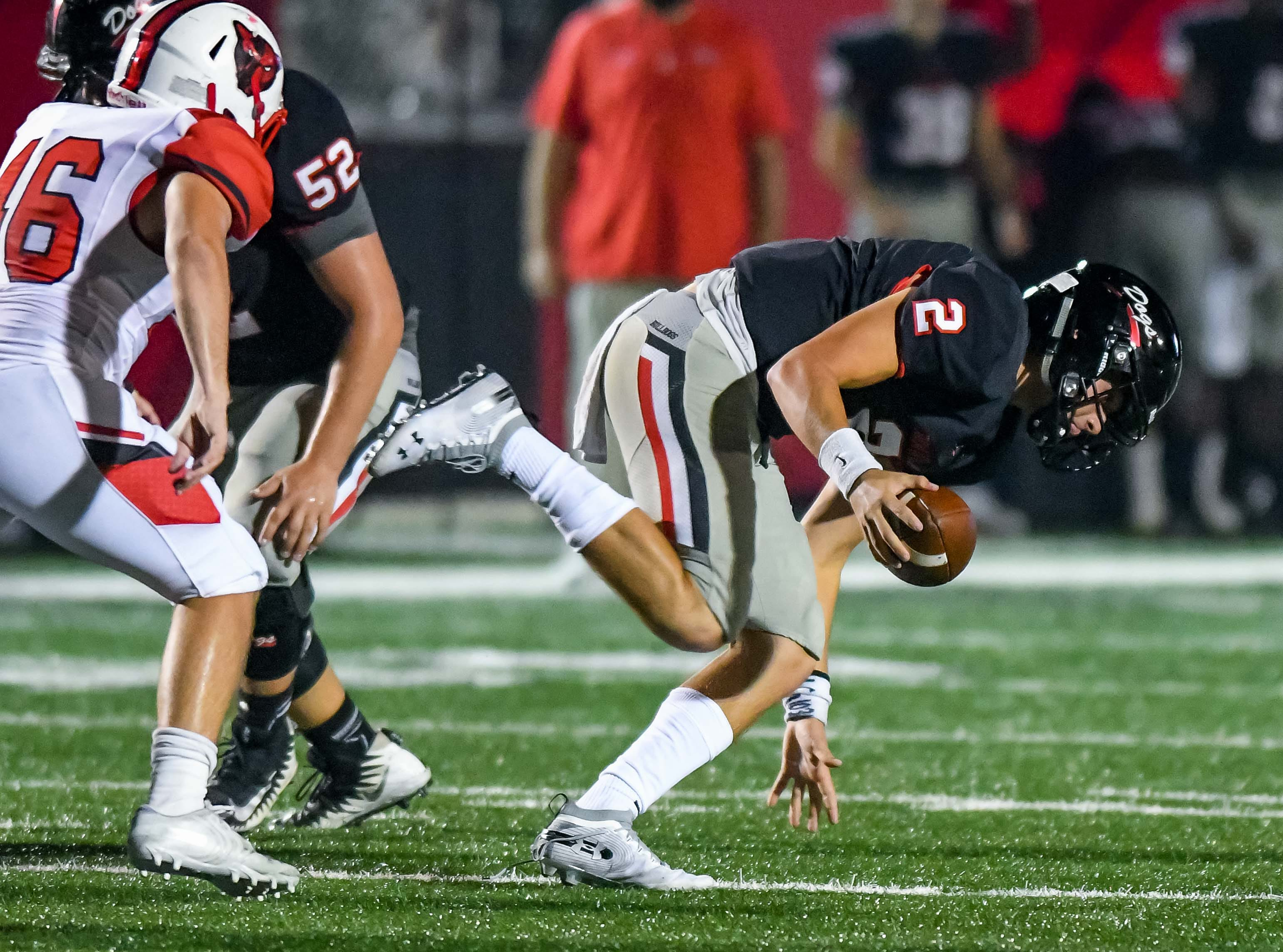 Brandon quarterback Wyatt Rogers (2) tries to keep his footing against Petal during game action held Friday October 5, 2018 in Brandon, Mississippi.(Photo/Bob Smith-For the Clarion Ledger)