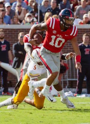 Ole Miss Rebels quarterback Jordan Ta'amu (10) breaks free for a touchdown against the Louisiana Monroe Warhawks during the first half at Vaught-Hemingway Stadium.
