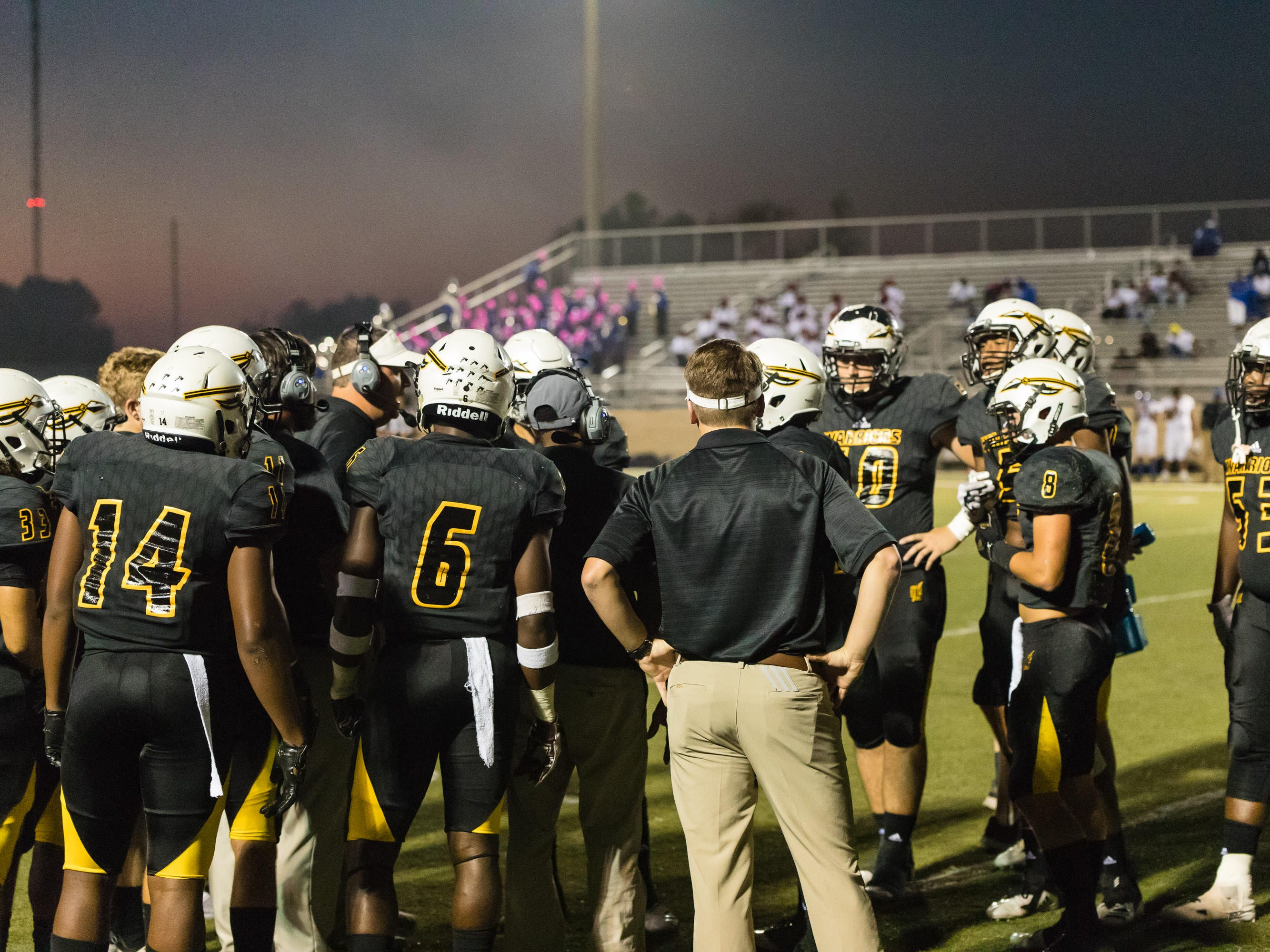 The Oak Grove Warriors huddle before taking the field for kickoff.