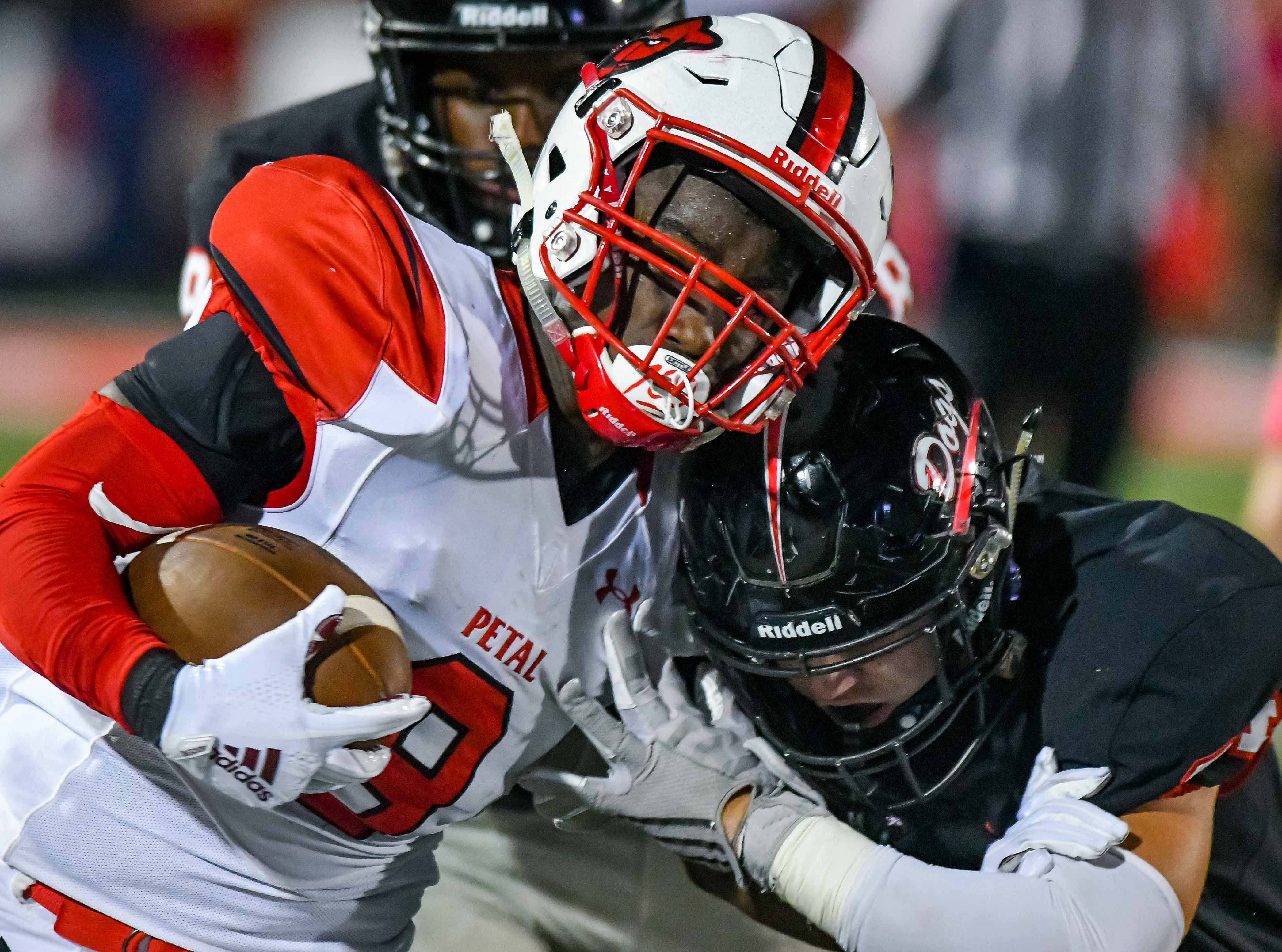 Petal's Micah McGowan (8) collides with a Brandon defender during game action held Friday October 5, 2018 in Brandon, Mississippi.(Photo/Bob Smith-For the Clarion Ledger)