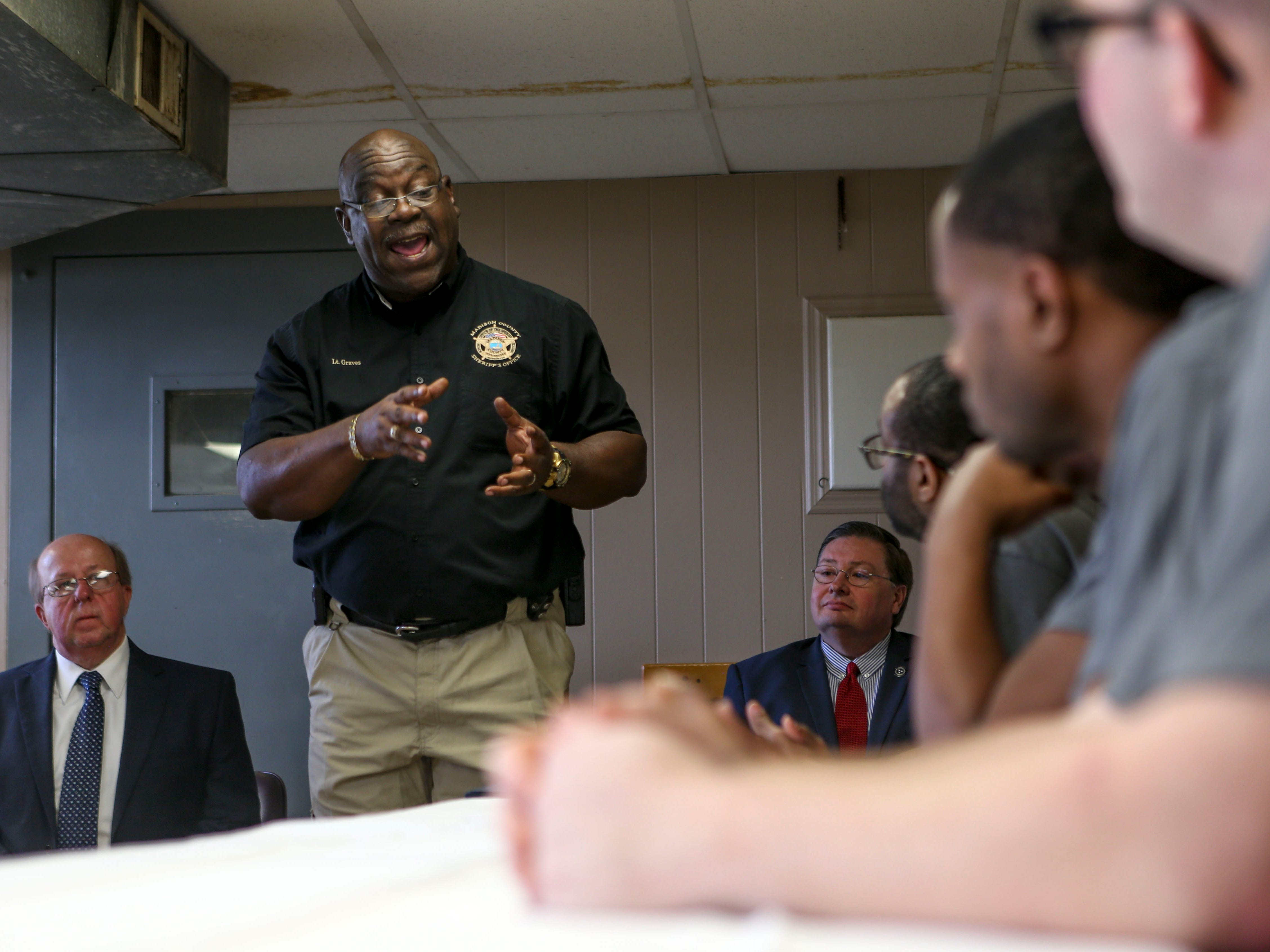Madison County Lt. Graves talks to graduates during a graduation ceremony for the InsideOut Dad program at Madison County Penal Farm in Jackson, Tenn., on Thursday, Oct. 4, 2018.